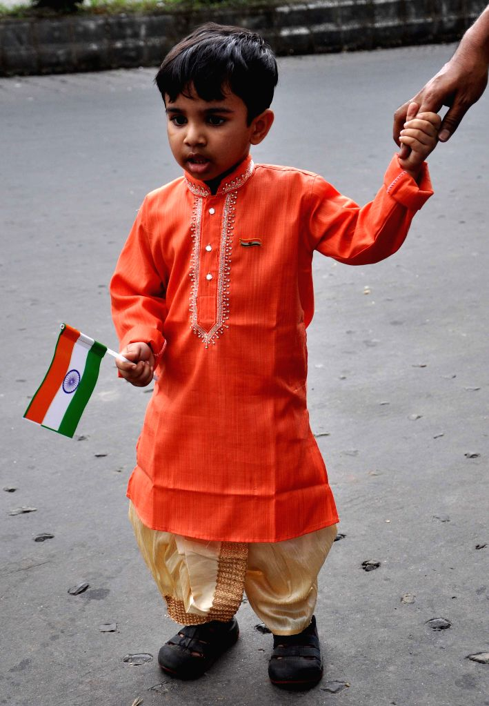 A child holds an Indian flag on Independence Day in Kolkata, on Aug 15, 2015.