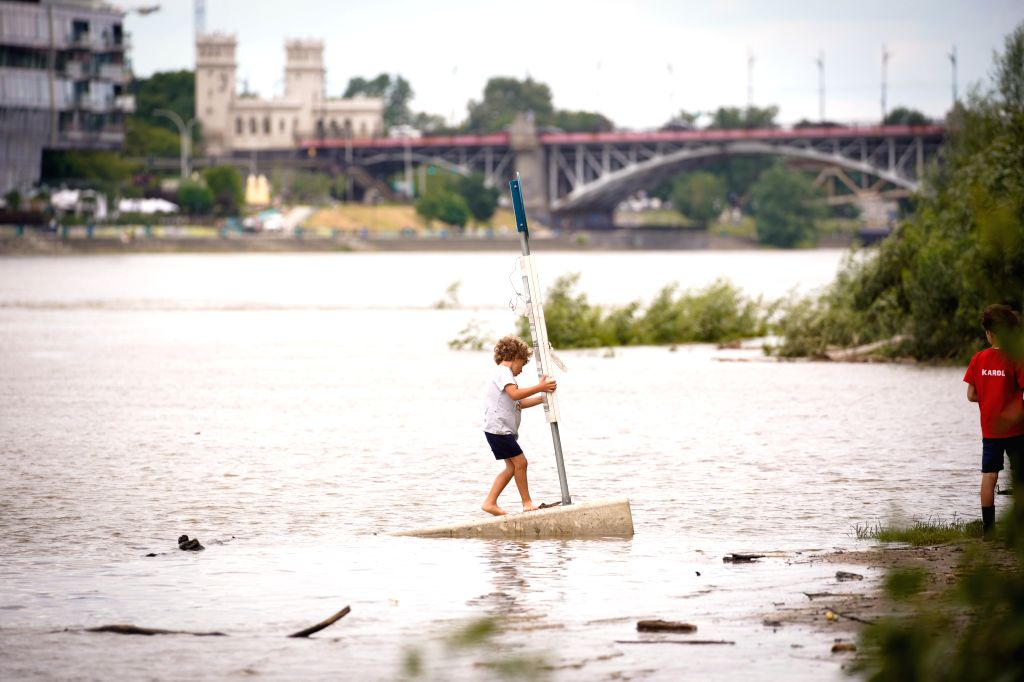 A child is seen playing at a flooded area in Warsaw, Poland, on June 30, 2020. Heavy downpours have caused flash floods in Warsaw on Monday evening, with over 300 ...