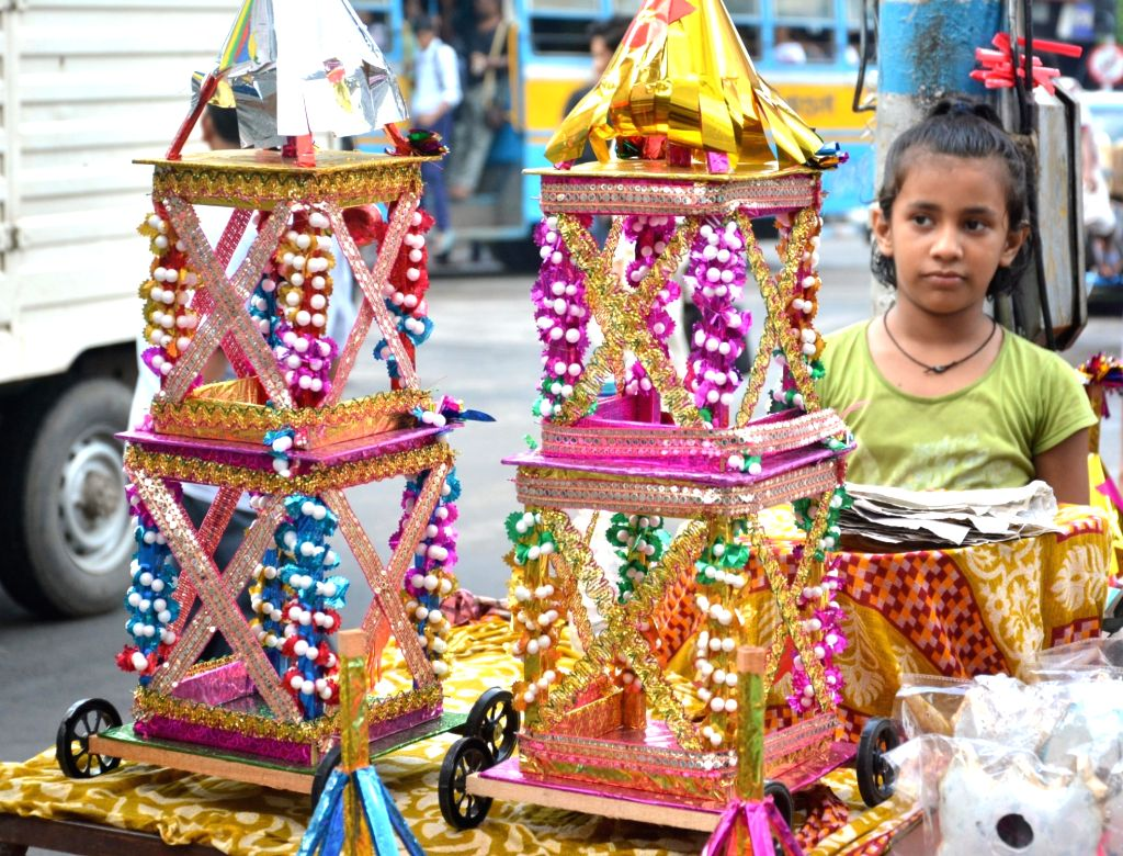 A child looks at raths -chariots- being sold on the eve of Jagannath Rath Yatra in Kolkata, on July 13, 2018.