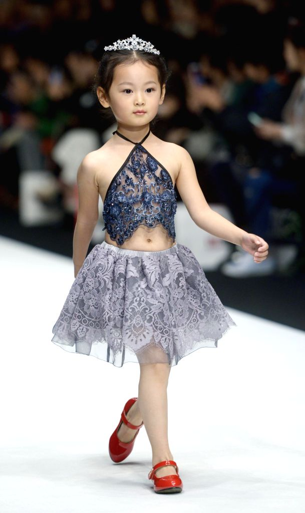 A child model presents a creation at the Sun Haitao Children's Wear Collection during the China Fashion Week in Beijing, capital of China, Oct. 28, 2015. ...