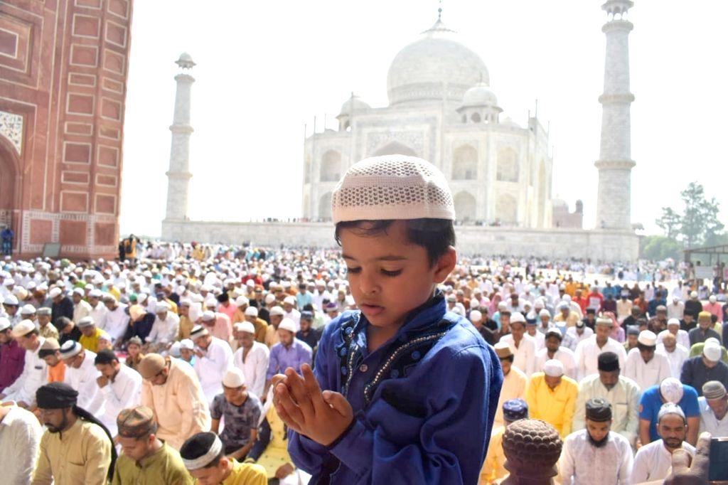 A child offers Eid-ul-Fitr namaz at the Taj Mahal in Agra on June 5, 2019.