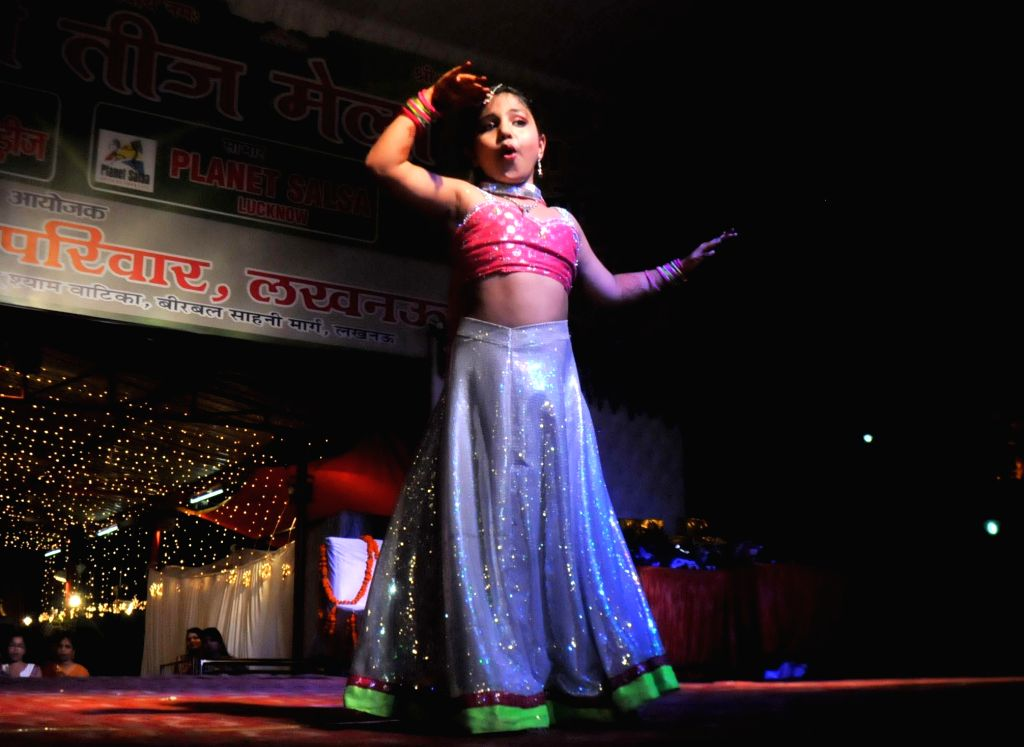 A child performs during a programme organised on Teej  at Shyam Khatu Mandir in Lucknow on July 30, 2014.
