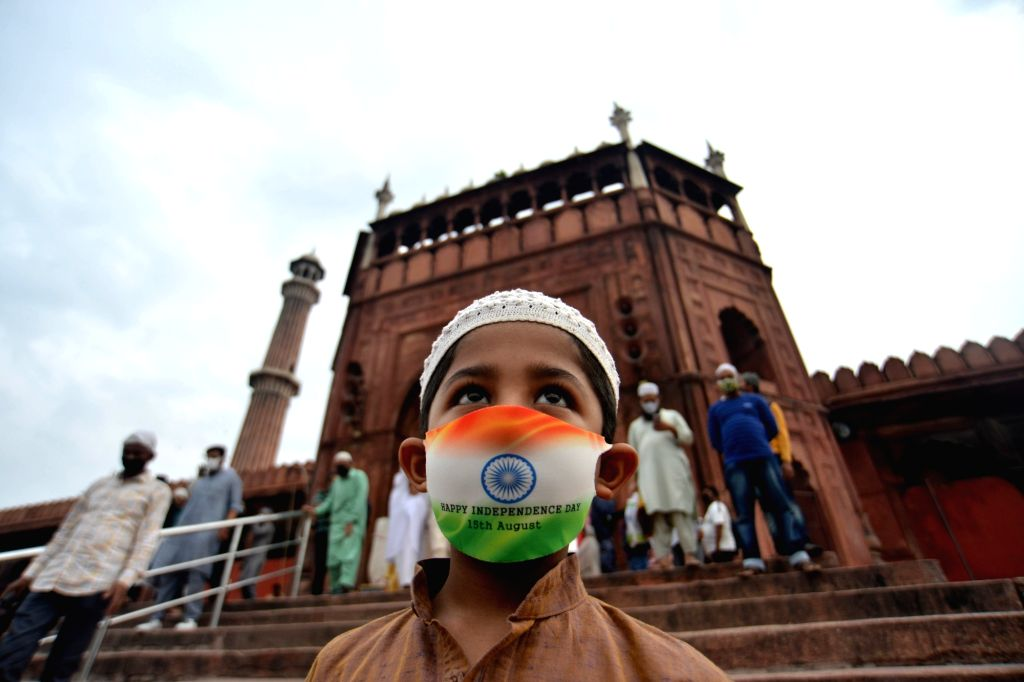 A child seen wearing a tricolored mask amid COVID-19 pandemic during Eid-ul-Adha celebrations at the Jama Masjid in Delhi on Aug 1, 2020.