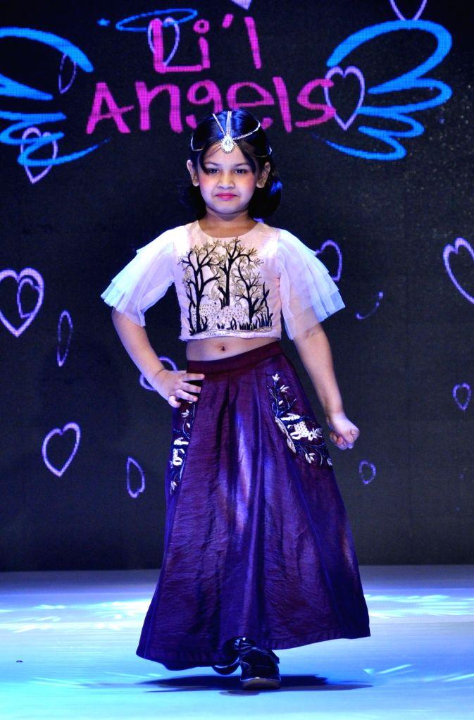 A child walks the ramp during Junior's Fashion Week in Kolkata on Sept 3, 2017.
