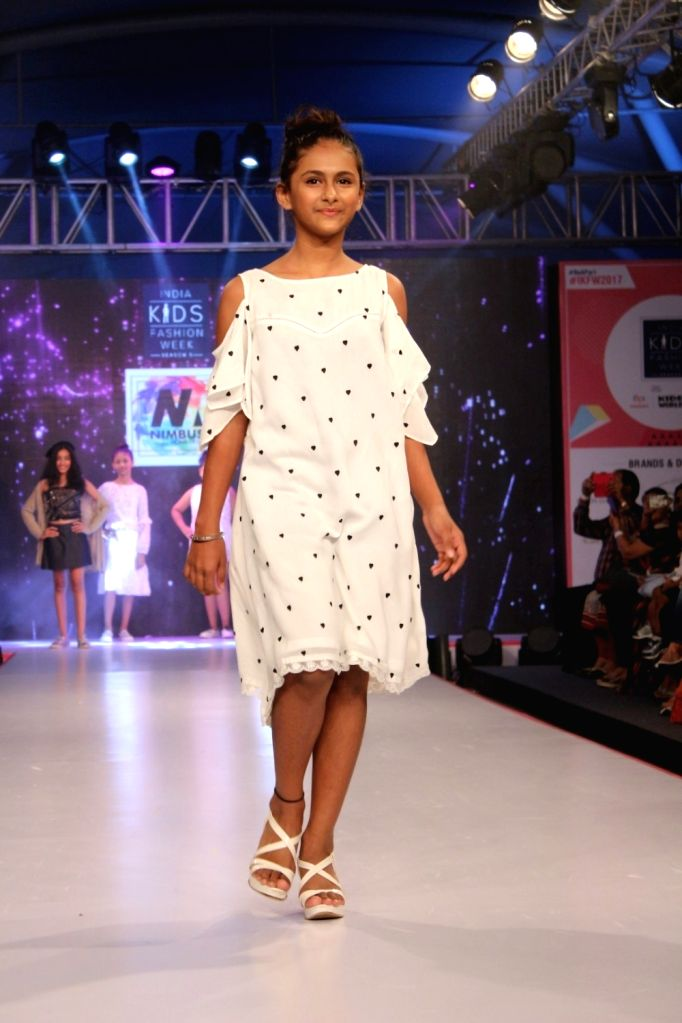 A child walks the ramp during the India Kids Fashion Week (IKFW) in Mumbai on Aug 12, 2017.