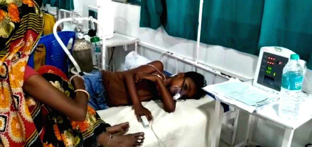 A child with encephalitis symptoms being treated at hospital in Muzaffarpur, Bihar on June 13, 2019.