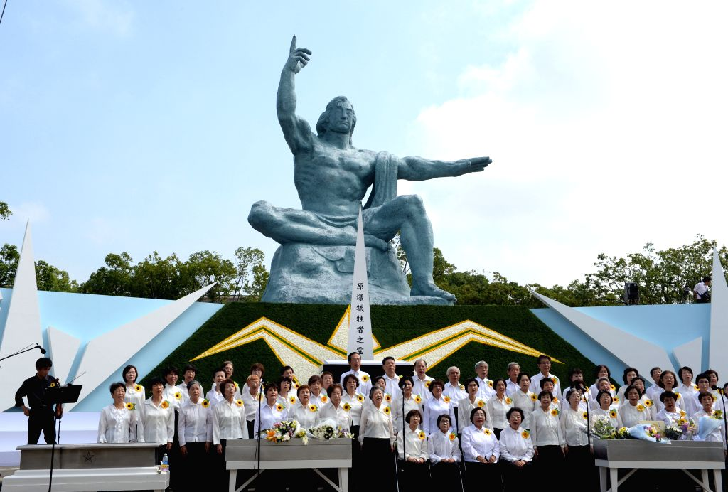 A chorus performs during a ceremony commemorating the 70th anniversary of the bombing of Nagasaki, at the Peace Park in Nagasaki, Japan, on Aug. 9, 2015. (Xinhua/Ma ...