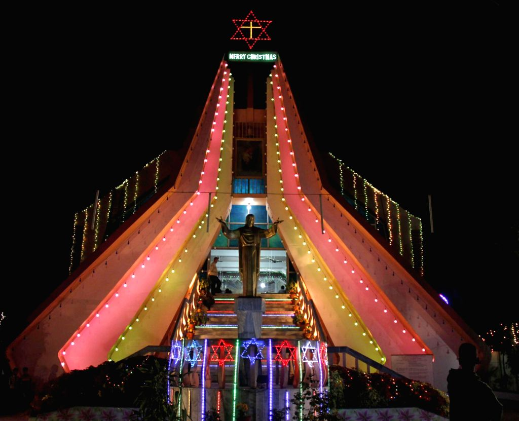 A church being beautifully illuminated ahead of Christmas in Guwahati on Dec.22, 2013.