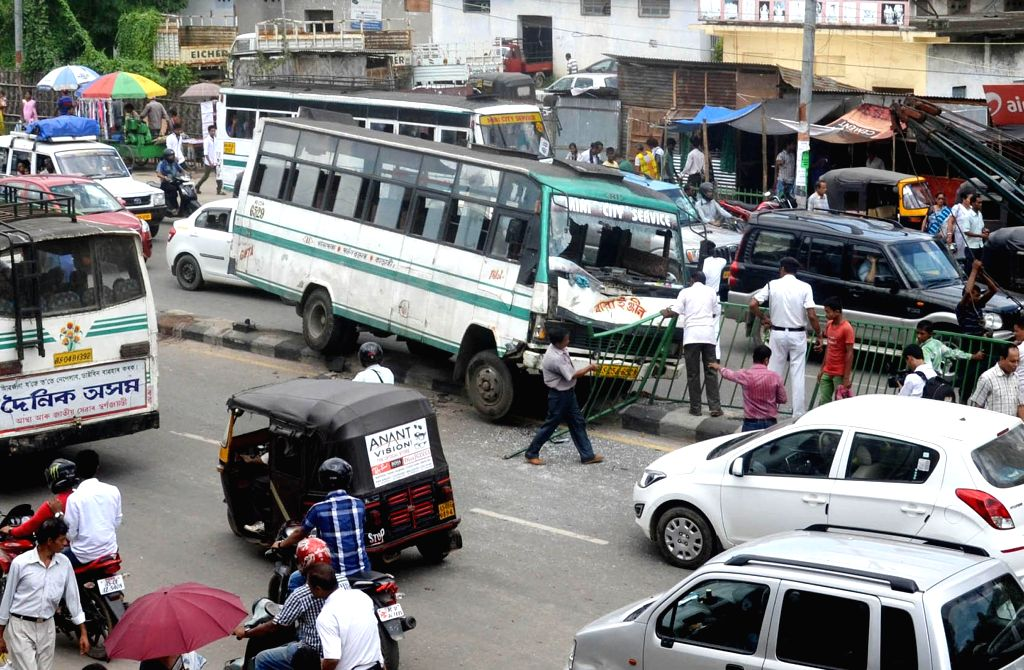 A city bus rams into road divider after the driver lost control over the wheels in Guwahati on Sept 8, 2014.