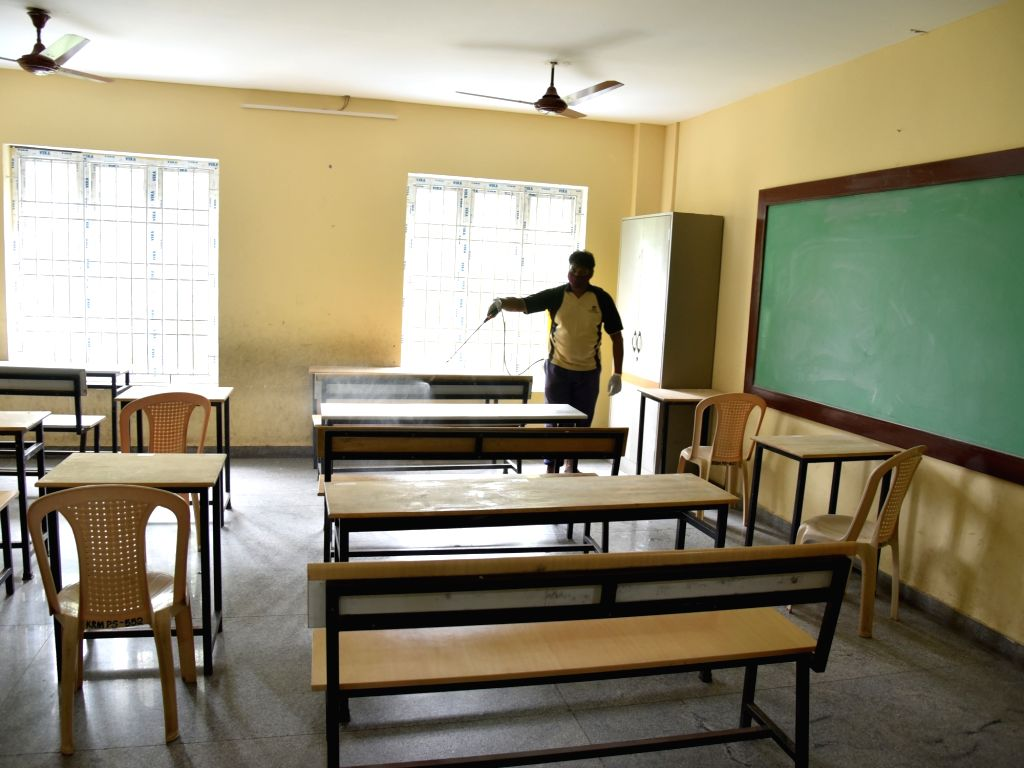 A classroom at a school (serving as examination center) being sanitised on the eve of the National-Eligibilty-cum-Entrance Test (NEET) examinations that are scheduled to be conducted across ...