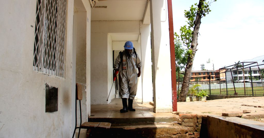 A cleaner disinfects a school in Colombo, Sri Lanka, on July 4, 2020. Sri Lankan government officially announced that all schools will reopen on July 6 for students ...