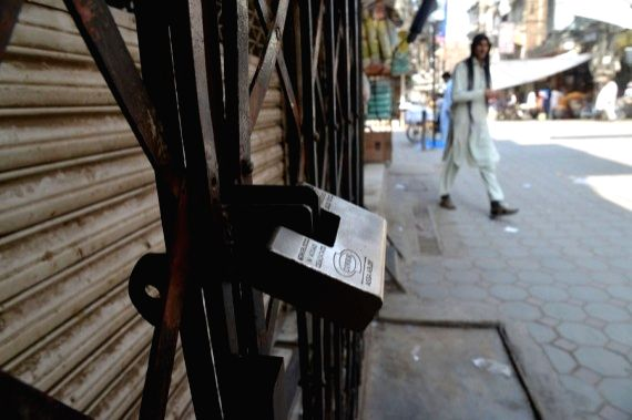 A closed shop is seen at a market in northwest Pakistan's Peshawar on May 8, 2021.