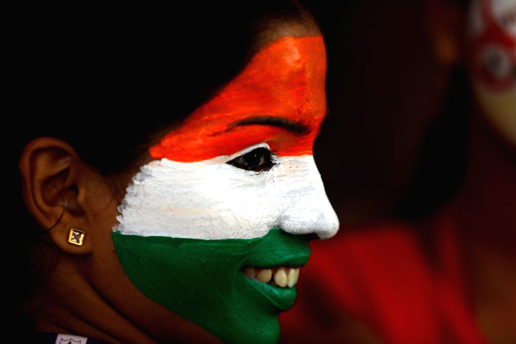 A college student with her face painted in tricolor participates in Republic Day celebrations in Chennai, on Jan 25, 2019.