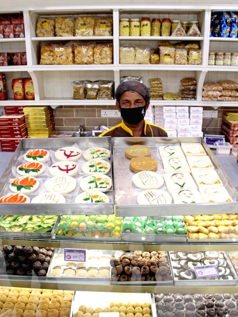 A confectioner sells sweets with symbols of political parties ahead of State Assembly elections, in Kolkata on Friday 05th March, 2021.