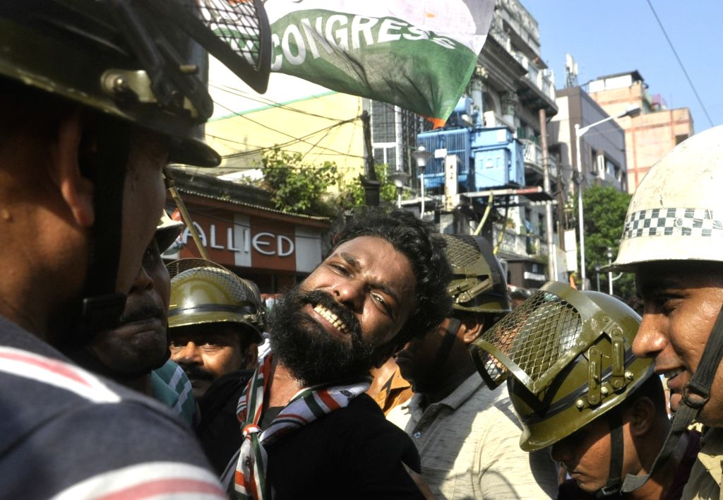 A Congress activist being detained during a demonstration against the Trinamool Congress-led state government over 'cut money', outside Lal Bazar Police headquarters in Kolkata on July 17, ...