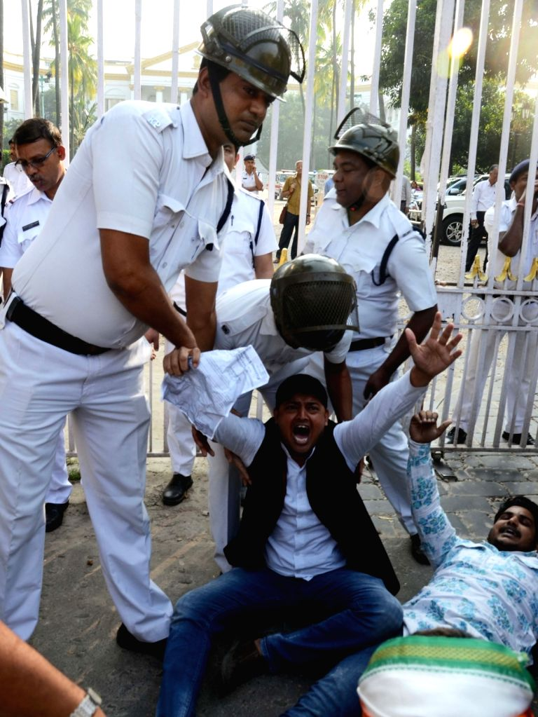 A Congress worker being taken away by the police during the party's demonstration outside Raj Bhawan after a bust of former West Bengal Chief Minister Bidhan Chandra Roy was found vandalised ... - Bidhan Chandra Roy