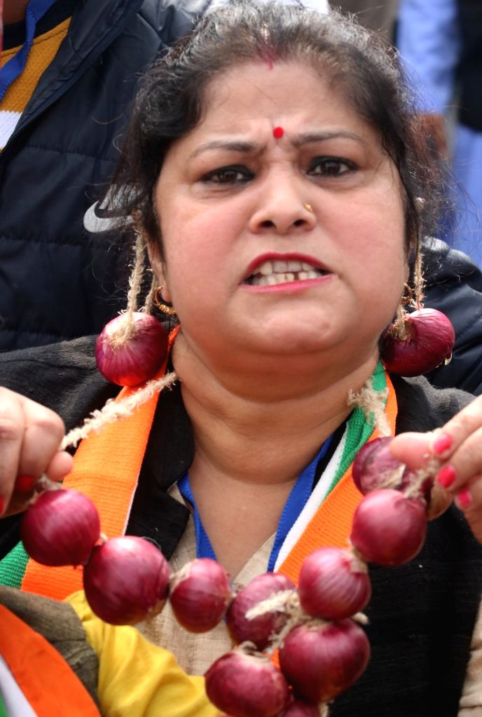 A Congress worker displays anger over the rising prices of onions across the country as she protests against the BJP Government by wearing onion ornaments during 'Bharat Bachao' Rally ...