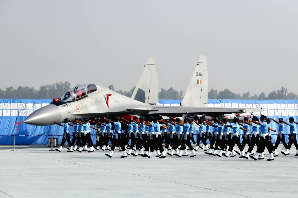 A contingent of Air Force officers marching past the recently inducted Rafale fighter jet at Hindon Air Force Station during the 88th Air Force Day celebrations in Ghaziabad, Uttar Pradesh ...