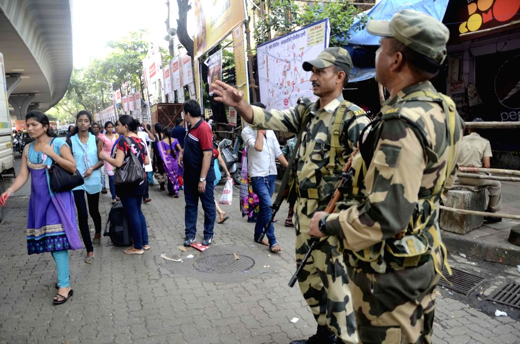 A contingent of BSF personnel stand guard during Ganesh festival at Lalbaug in Mumbai on Sept. 6, 2014.