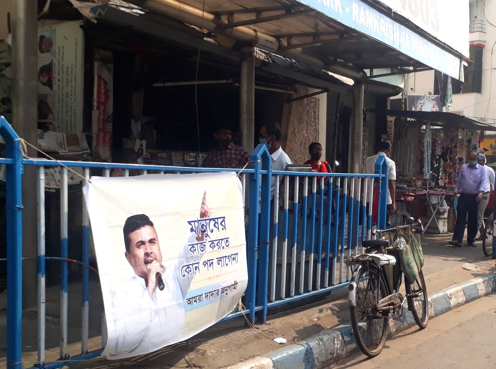 A controversial poster of West Bengal's ruling Trinamool Congress' disgruntled party heavyweight Suvendu Adhikari at a roadside in Kolkata on Dec 3, 2020. State Irrigation and Transport ... - Suvendu Adhikari and Mamata Banerjee