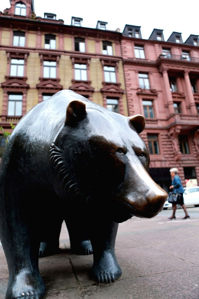 A copper bear sculpture installed outside the Frankfurt Stock Exchange in Frankfurt, Germany. (File Photo: Xinhua/Luo Huanhuan/IANS)