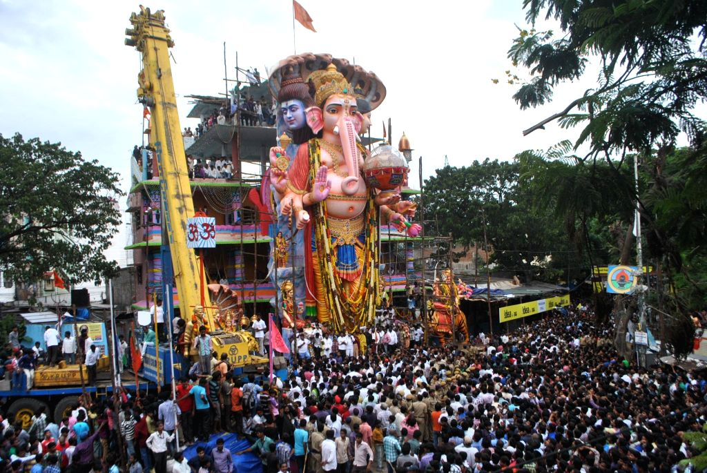 A crane lifts a 60-feet-high Ganesh idol for immersions at Khairatabad, Hyderabad on Sept 8, 2014.