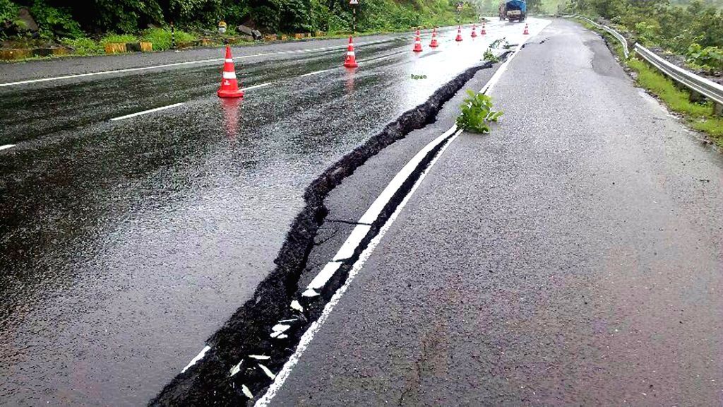 A crater that developed on Kasara ghat expressway after heavy rainfalls in Maharashtra on July 31, 2014.