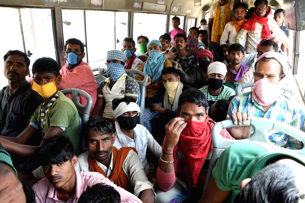 A crowded bus carrying migrant workers heading back home seen on Day 8 of the 21-day nationwide lockdown imposed as a precautionary measure to contain the spread of coronavirus, in Patna on ...