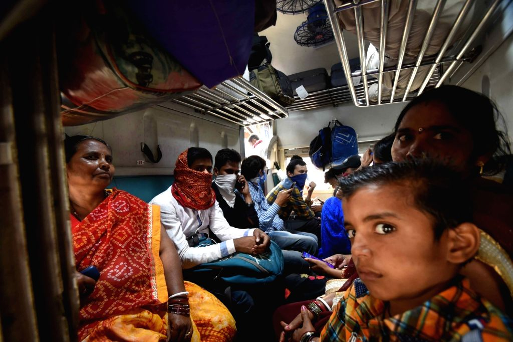 A crowded railway coach amid COVID-19 pandemic, at Patna Junction railway station on March 21, 2020.