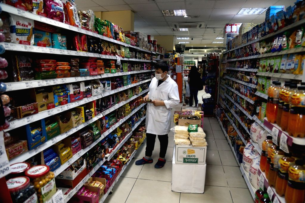 A customer wearing a mask shops at a supermarket in Ankara, Turkey, on Sept. 11, 2020. Turkey confirmed 1,671 new COVID-19 cases on Friday, raising the total ...