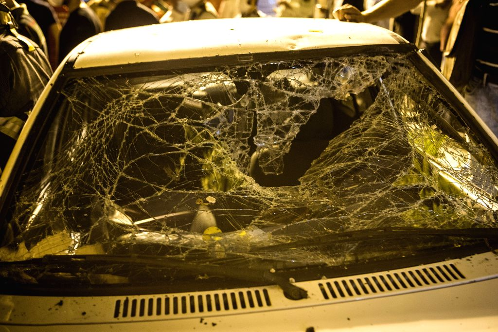 A damaged car is seen at the explosion site in Tehran, Iran, June 30, 2020. At least 19 people were killed in an explosion at a clinic in the northern district of ...