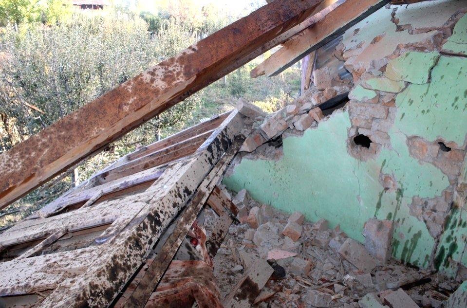A damaged house in Tumna village.
