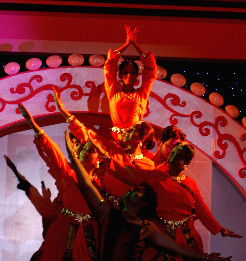 """A dance group at the stage, in occasion of beauty contest  organised by """"Chandrani Pearls"""" in Kolkata on Thursday."""