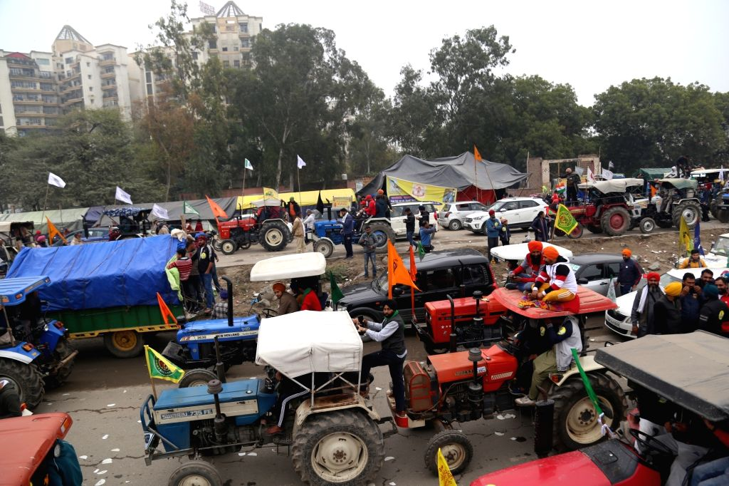 "A day ahead of the next round of talks with the Union government, thousands of farmers organised a 'tractor march', describing the event as a ""rehearsal"" for a similar roadshow ..."