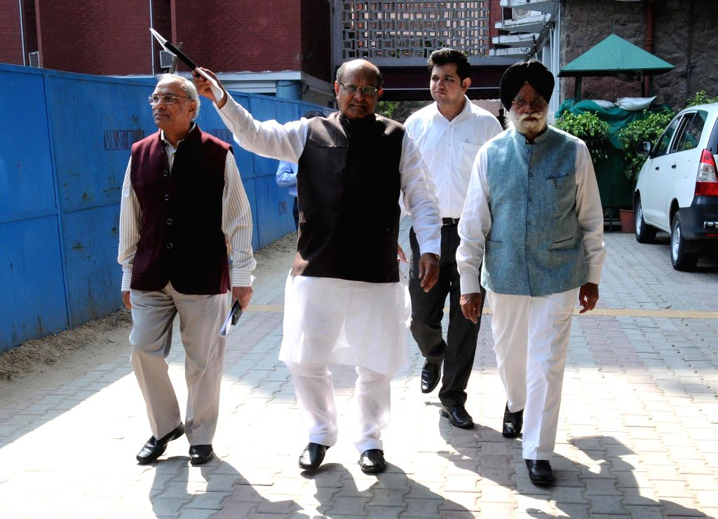 A delegation comprising of JD (U) GS K C Tyagi, Congress` KC Mittal and eminent lawyer and Rajya Sabha MP KTS Tulsi come out of the Election Commission office in New Delhi on Oct 26, 2015.