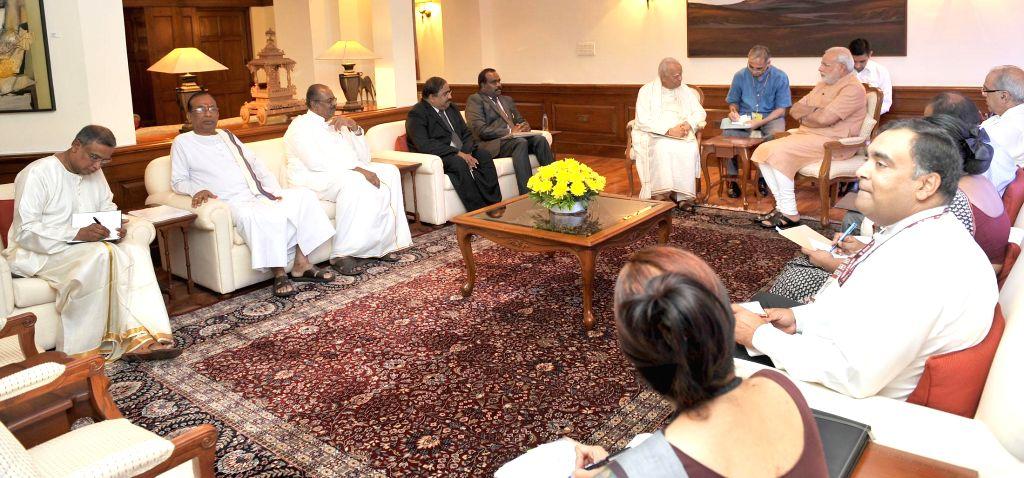 A delegation from Tamil National Alliance, Sri Lanka calls on the Prime Minister, Narendra Modi, in New Delhi on Aug. 23, 2014. - Narendra Modi