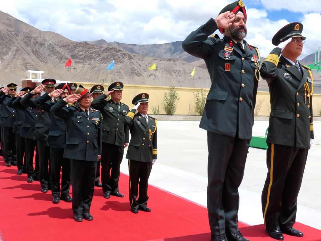 A delegation led by Brigadier J.K.S. Virk from India meets a delegation led by Senior Colonel Chen Zheng Shan from China during a ceremonial border personnel meeting to mark the People's ...