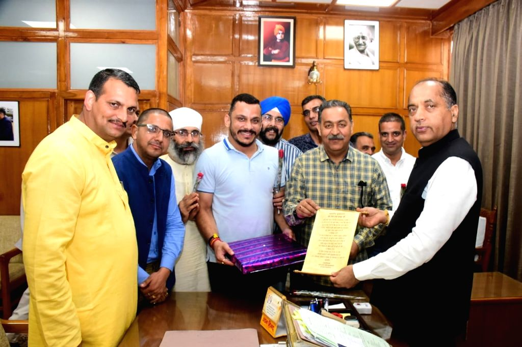 A delegation led by Rajesh Mahindroo calls on Himachal Pradesh Chief Minister Jai Ram Thakur in Shimla on Sep 13, 2019. - Jai Ram Thakur