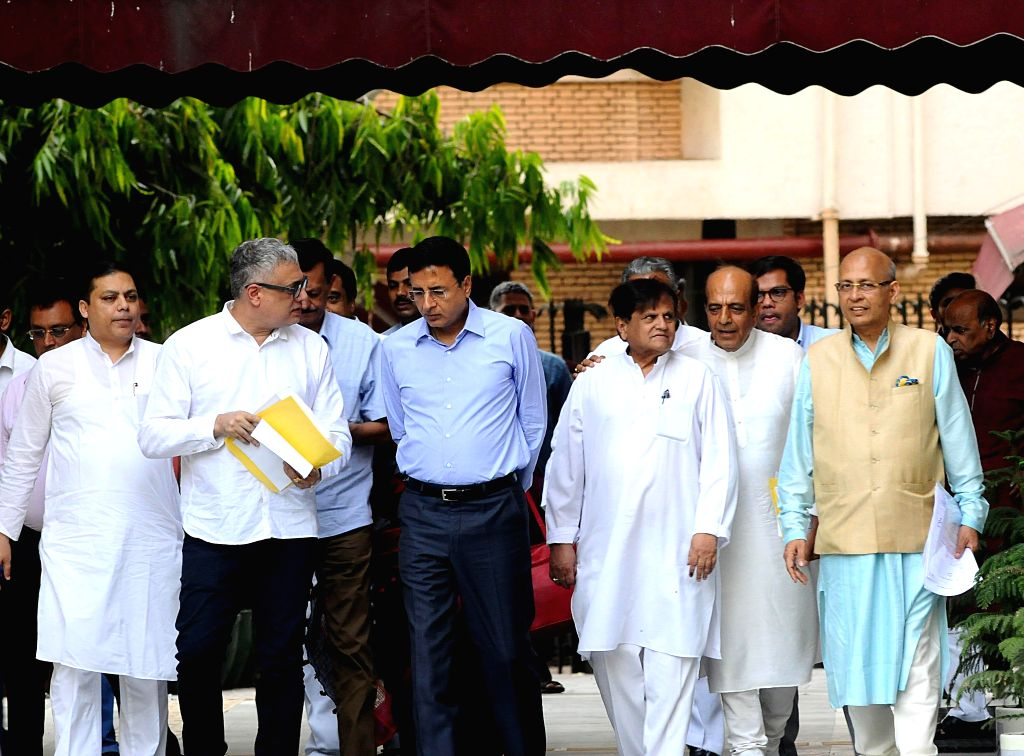 A delegation led by TMC leaders Derek O'Brien, Dinesh Trivedi and Congress leaders Randeep Singh Surjewala, Ahmed Patel and Abhishek Manu Singhvi, comes out after meeting the Chief ... - Randeep Singh Surjewala and Ahmed Patel
