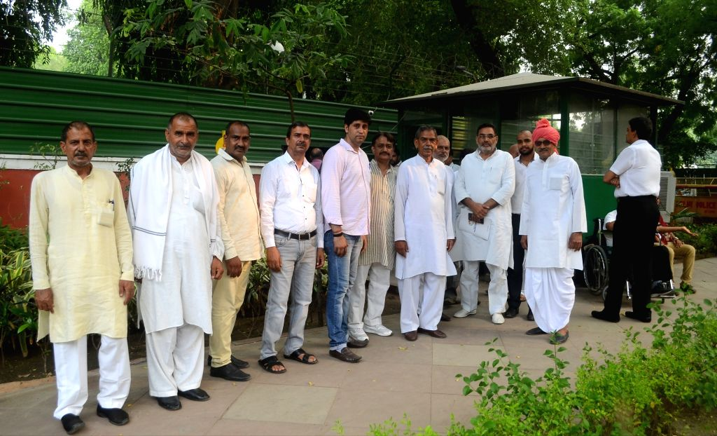 A delegation of farmers arrive to meet Union Home Minister Rajnath Singh at his residence, in New Delhi on July 12, 2018. - Rajnath Singh