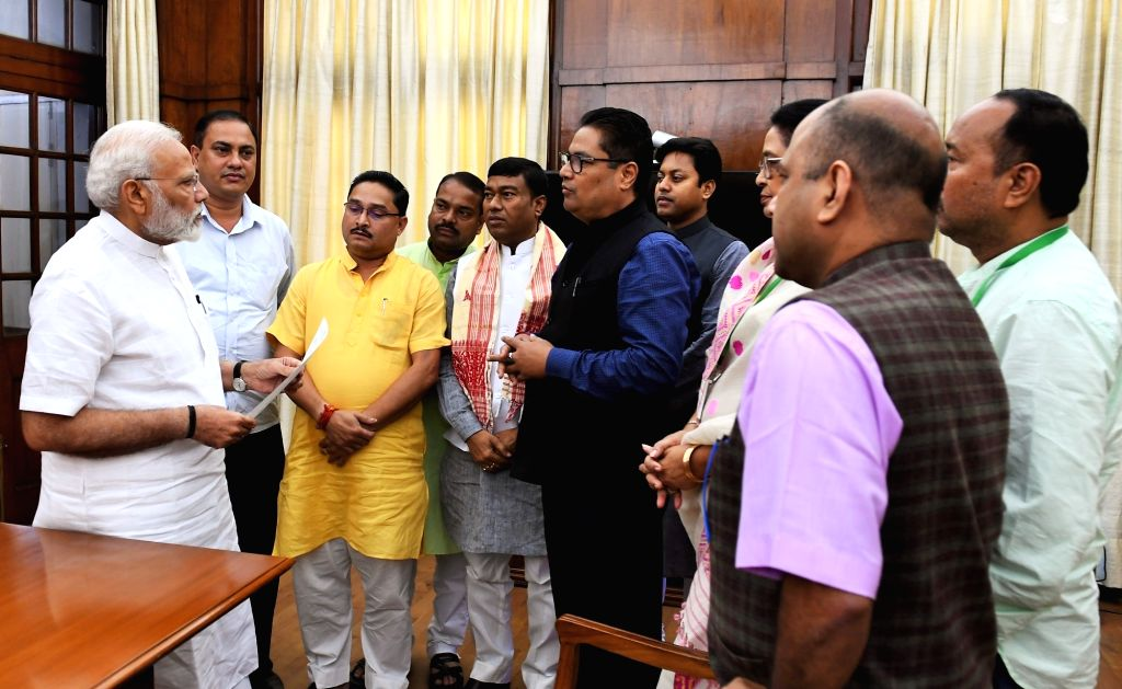 A delegation of MPs from Assam led by Union Minister Rameswar Teli call on Prime Minister Narendra Modi, in New Delhi on July 19, 2019. - Rameswar Teli and Narendra Modi