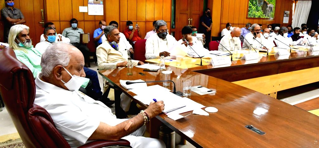 A delegation of opposition party leaders and farmers organisations led by Congress leaders Siddaramaiah and DK Shivakumar met Karnataka Chief Minister BS Yeddiyurappa to discuss COVID-19 ... - B
