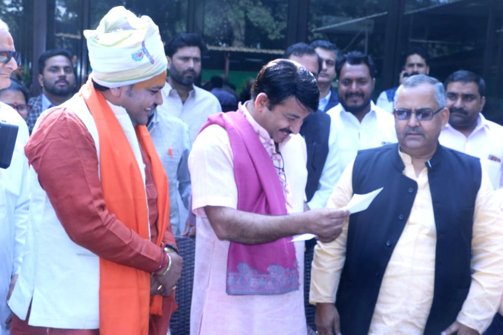 A delegation of over 25 Vishva Hindu Parishad (VHP) leaders led by Bachan Singh hands over a memorandum for the construction of Ram temple to BJP MP Manoj Tiwari after meeting him at his ... - Bachan Singh