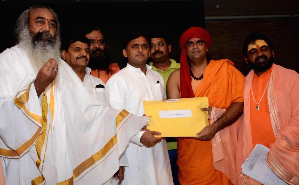A delegation of priests from Kairana in Uttar Pradesh's Shamli district submit a report on mass exodus of Hindu families in the region to Uttar Pradesh Chief Minister Akhilesh Yadav in ... - Akhilesh Yadav