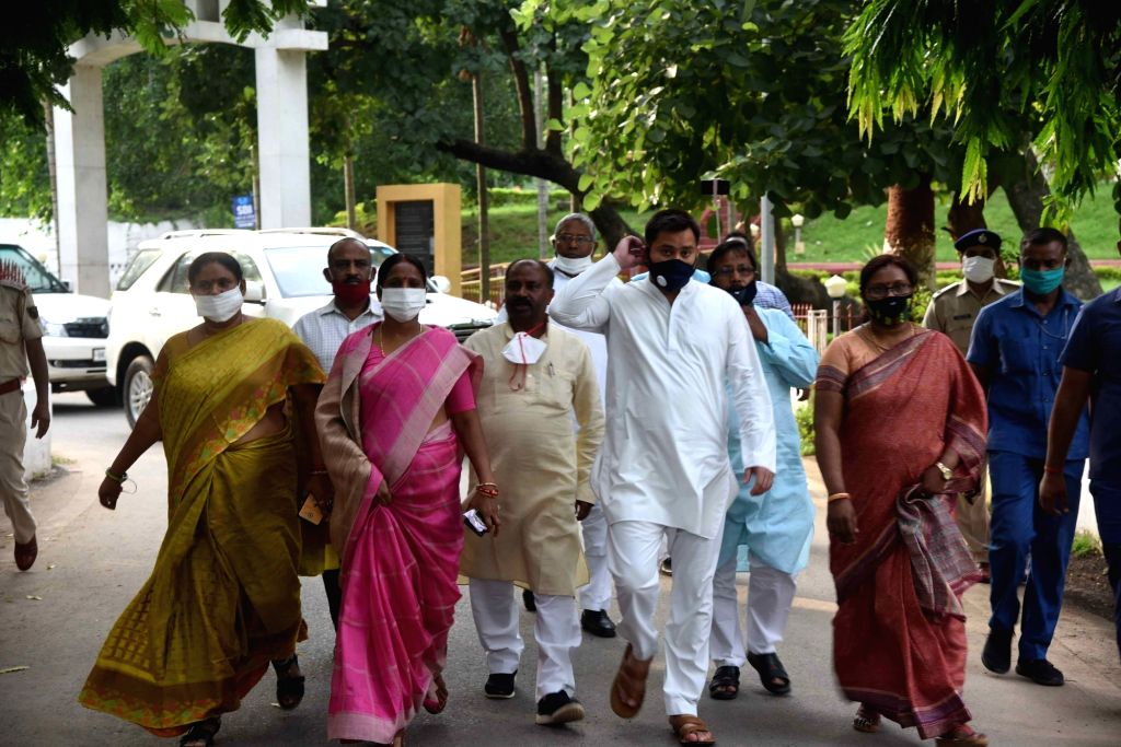 A delegation of RJD leaders led by Tejashwi Yadav comes out of Raj Bhavan after submitting a memorandum to Bihar Governor Phagu Chauhan over the SC/ST Reservation issue, in Patna on June 23, ... - Tejashwi Yadav and Phagu Chauhan