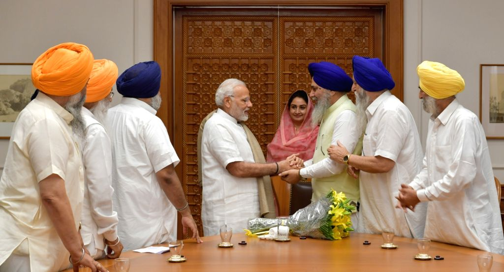 A delegation of SGPC led by Union Food Processing Industries Minister Harsimrat Kaur Badal calls on Prime Minister Narendra Modi, in New Delhi, on June 8, 2017. - Harsimrat Kaur Badal and Narendra Modi