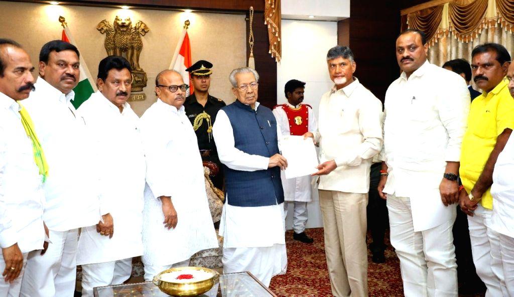 A delegation of TDP leaders led by Former Andhra Pradesh Chief Minister and party supremo N. Chandrababu Naidu, calls on Governor Biswa Bhushan Harichandran and submits a memorandum, at ... - N. Chandrababu Naidu