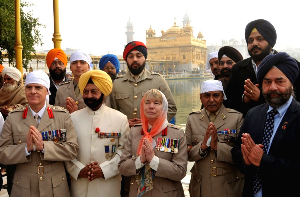 A delegation of the British Army led by Brigadier Celia Jane Harvey pay obeisance at the Golden Temple in Amritsar on Dec 11, 2019.