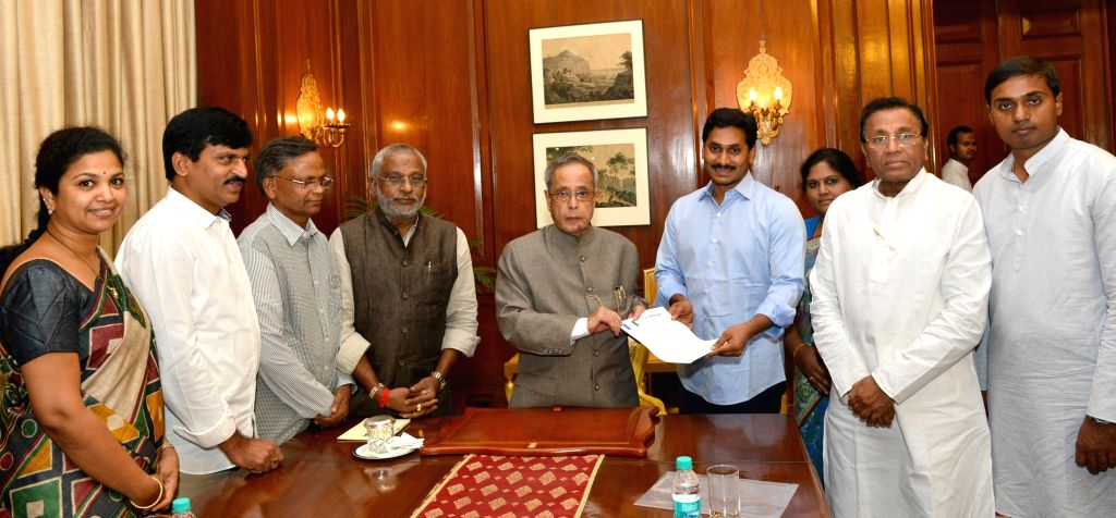 A delegation of Y S R Congress led by party president YS Jaganmohan Reddy meets President Pranab Mukherjee at Rashtrapati Bhawan in New Delhi on July 10, 2014.