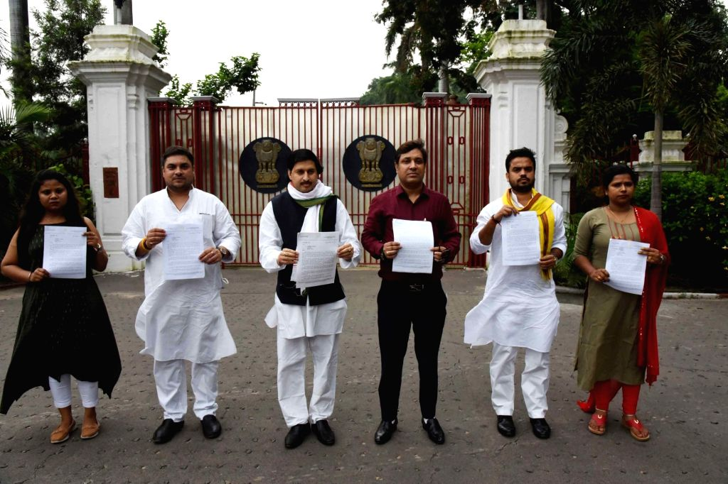 A delegation of Youth Congress workers show a memorandum demanding a CBI investigation into the death of late actor Sushant Singh Rajput as they arrive to meet Bihar Governor Phagu Chauhan at ... - Sushant Singh Rajput and Phagu Chauhan